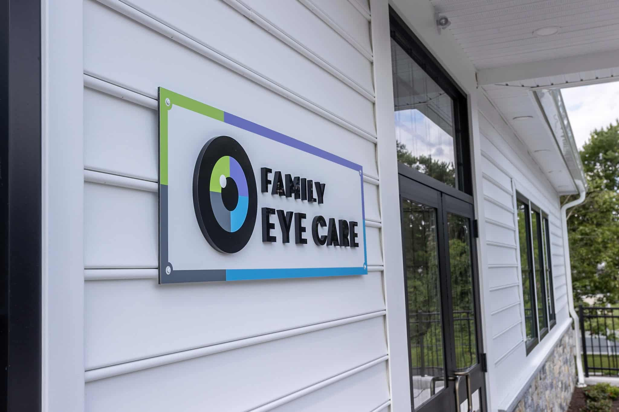 Exterior view of the Family Eye Care Bristol office displaying a sign with the logo inside.